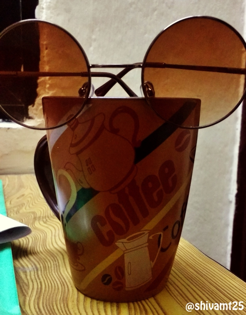 coffee cup and sunglasses